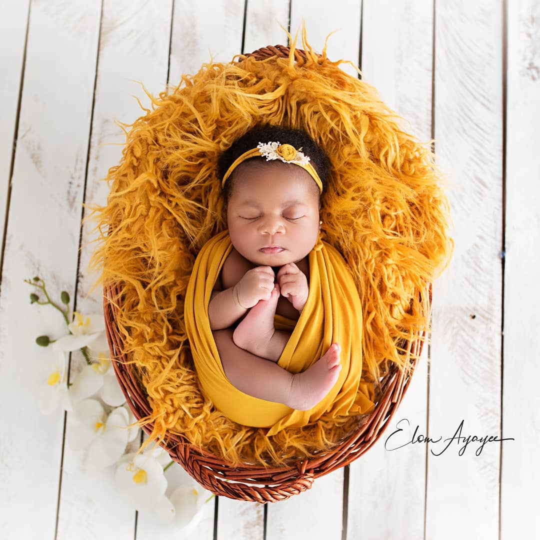 newborn photography baby girl yellow orange swaddle fur headband studio set
